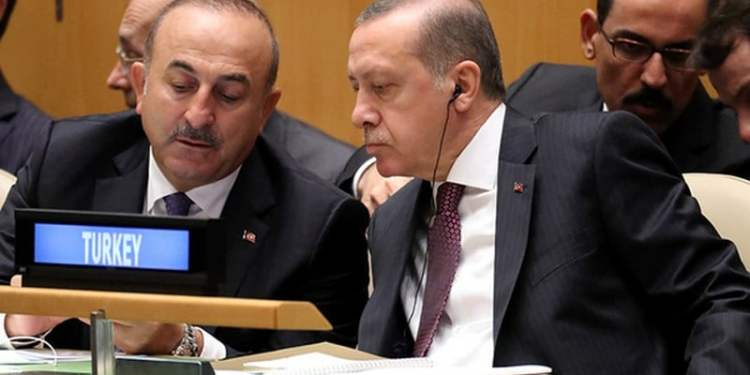 President Recep Tayyip Erdogan of Turkey speaks with his Foreign Minister Mevlut Cavusoglu (L) during the 71st United Nations General Assembly in Manhattan, New York, U.S. September 20,  2016. REUTERS/Carlo Allegri - RTSOLUH