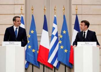 French President Emmanuel Macron and Greek Prime Minister Kyriakos Mitsotakis attend a joint statement at the Elysee Palace in Paris, France January 29, 2020. REUTERS/Benoit Tessier/Pool