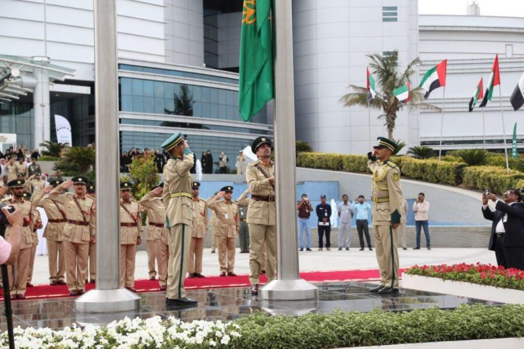 Maj Gen Abdullah Khalifa Al Marri is raised the flag with the new Dubai Police corporate identity logo on Thursday at Dubai Police general headquarters.