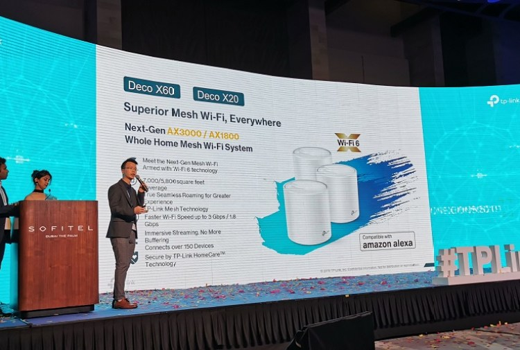 Ricky Li showcasing the features of the Tp_Link DecoX60 and DecoX20 Home Mesh Wi-Fi smart routers