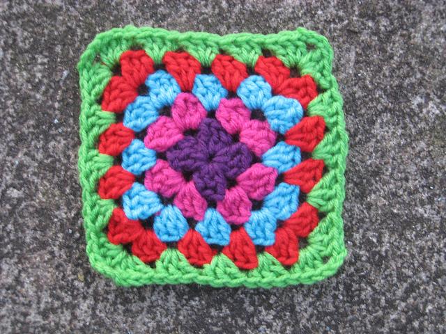 Five round multicolor crochet granny square