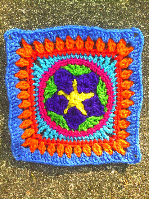 crochet square with a crochet star in the center