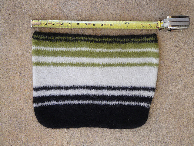 A felted crochet wool bag measures sixteen inches across