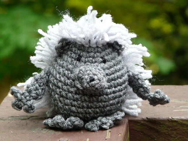 an amigurumi porcupine with yarn quills