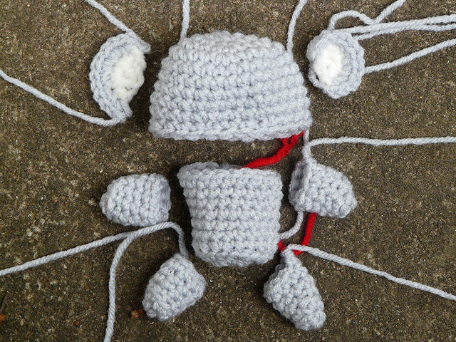crochet pieces of an amigurumi koala