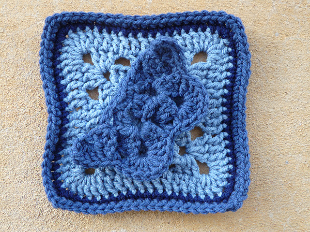 A crochet square with a crochet butterfly to be appliqued
