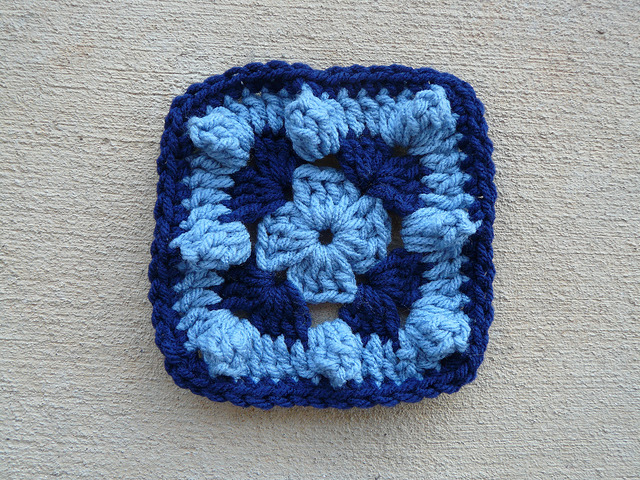 A blue textured crochet square