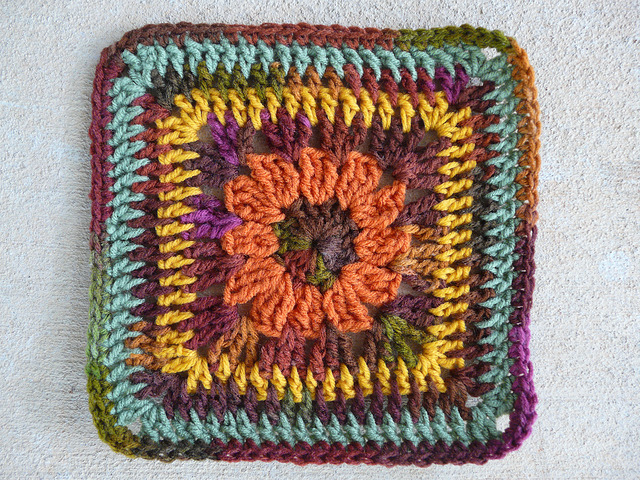 crochet granny square with a crochet flower center