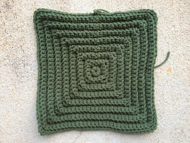 A large textured crochet square worked in green