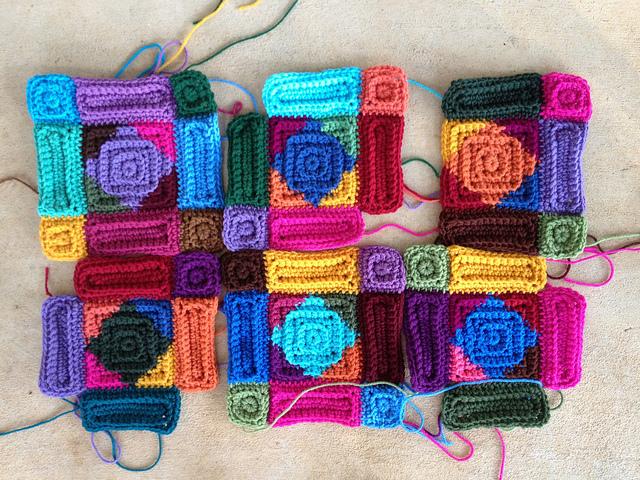 six multicolor crochet squares