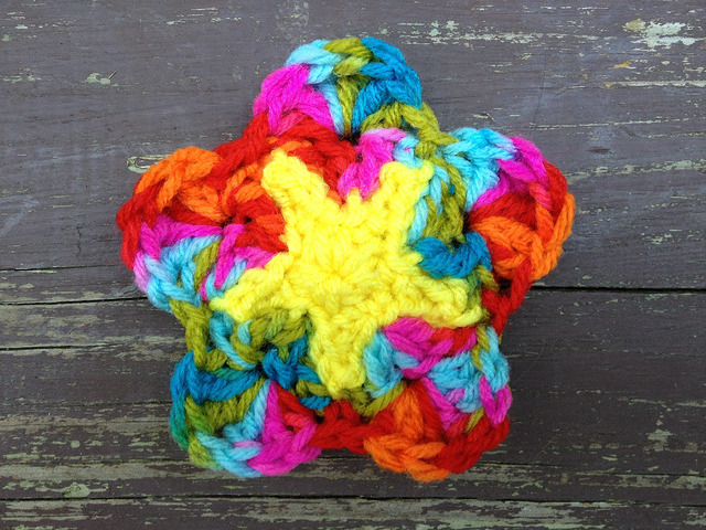 crochet star at the center of a crochet square