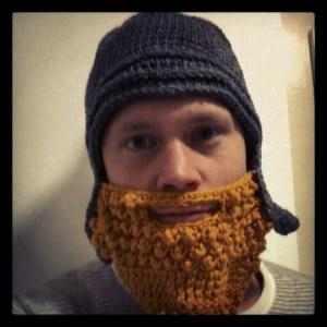 Simon wearing his crochet Assyrian helmet and beard