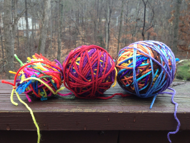Three scrap yarn balls