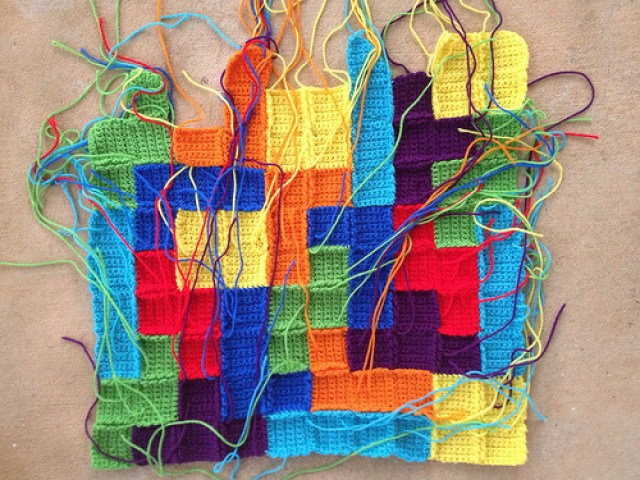 crochet squares joined into crochet tetrominos
