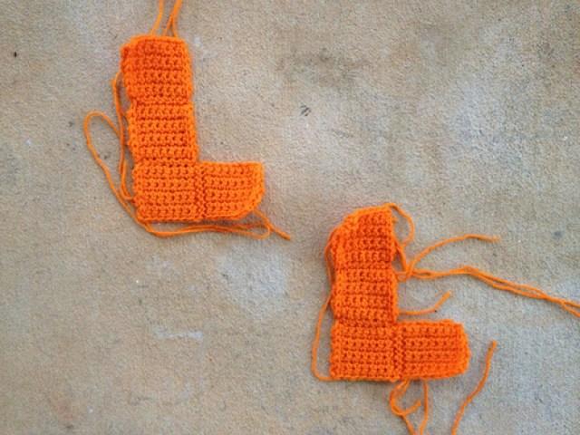 I finish two orange crochet tetrominos