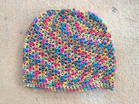 A completed baby soft crochet chemo cap to fit an adult
