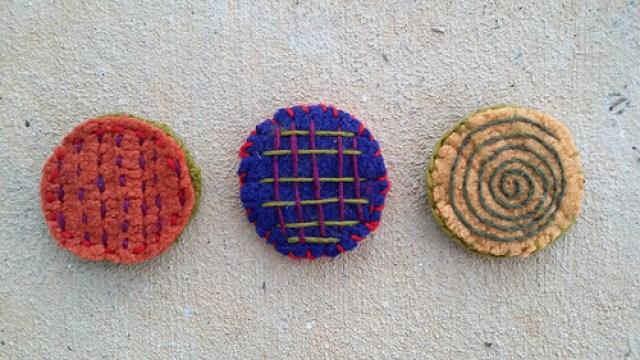 three felted crochet circles