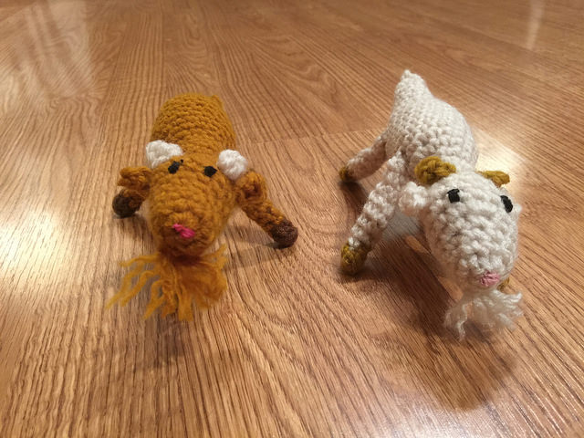 Ccrochet goats scamper across the floor