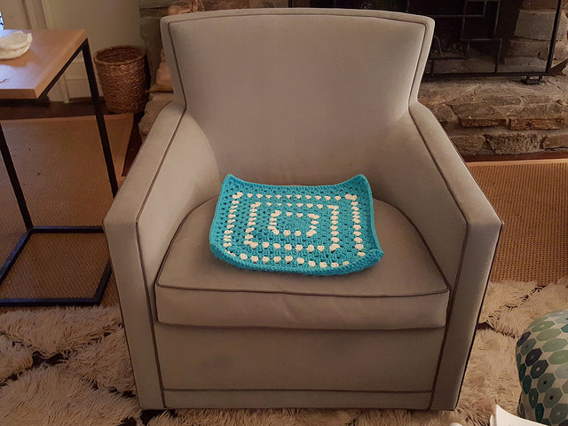 crochet pet mat on the dog's chair