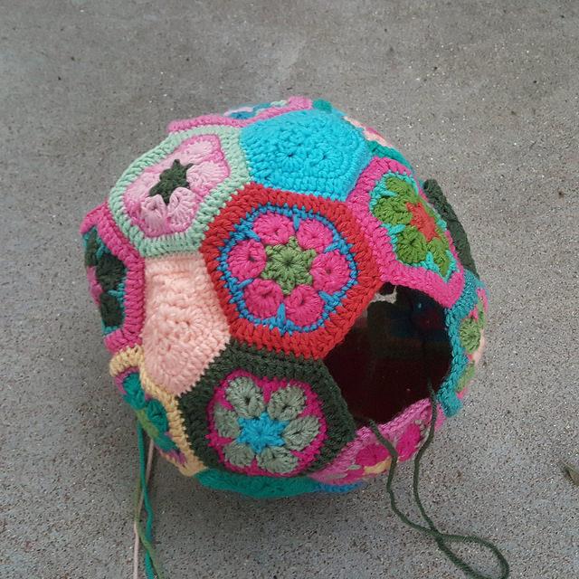 a nearly assembled crochet soccer ball