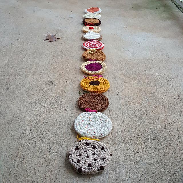 thirteen crochet cookies for a crochet scarf