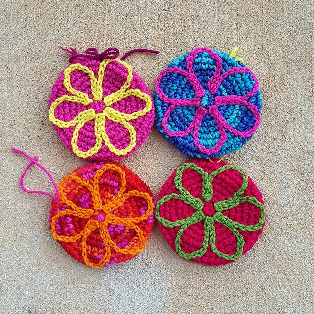 four crochet flower motifs