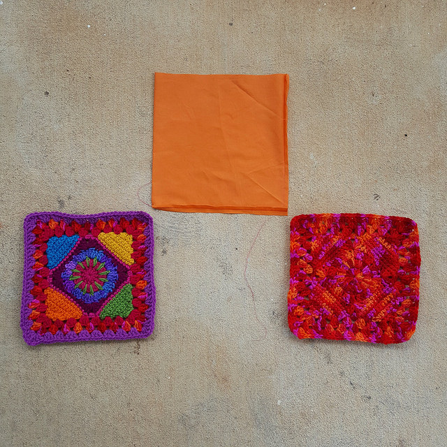 two granny squares and a fabric lining for a crochet bag