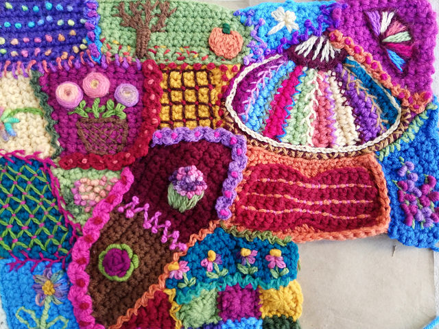 The upper right hand corner of the crochet crazy quilt panel finally tricked out to my satisfaction