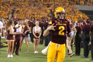 Arizona State quarterback Mike Bercovici runs out onto the field for the start of the game. (Photo: Scotty Bara/WCSN)