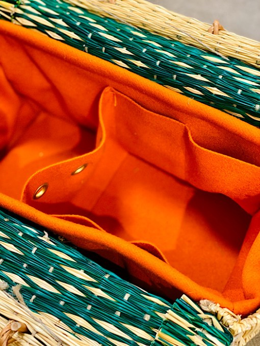 close up of burel lining CESTA reed project basket bright orange