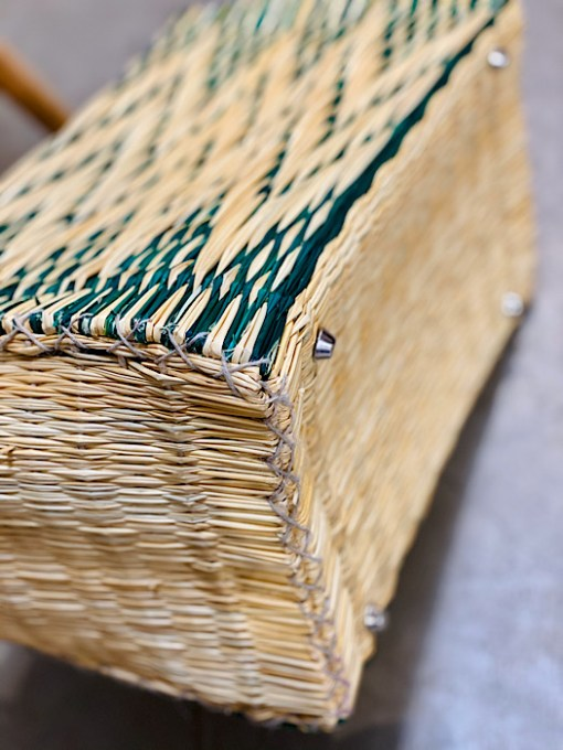 close up of bottom studs lining CESTA reed project basket