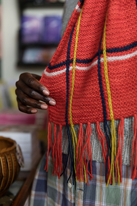 close up from a black woman modeling a striped shawl of Laine Publishing - 52 Weeks of Shawls