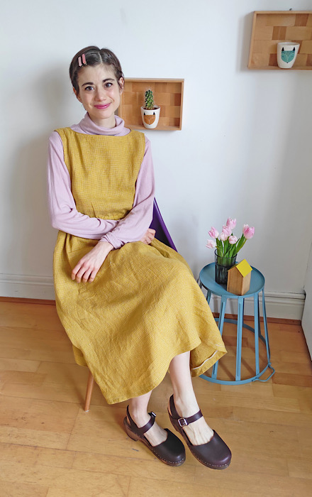 Modeling sitting down for Sewing Class: the Apricot Pinafore Dress by Cocowawa Crafts