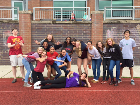 A group of seniors pose to represent their respective college choices.