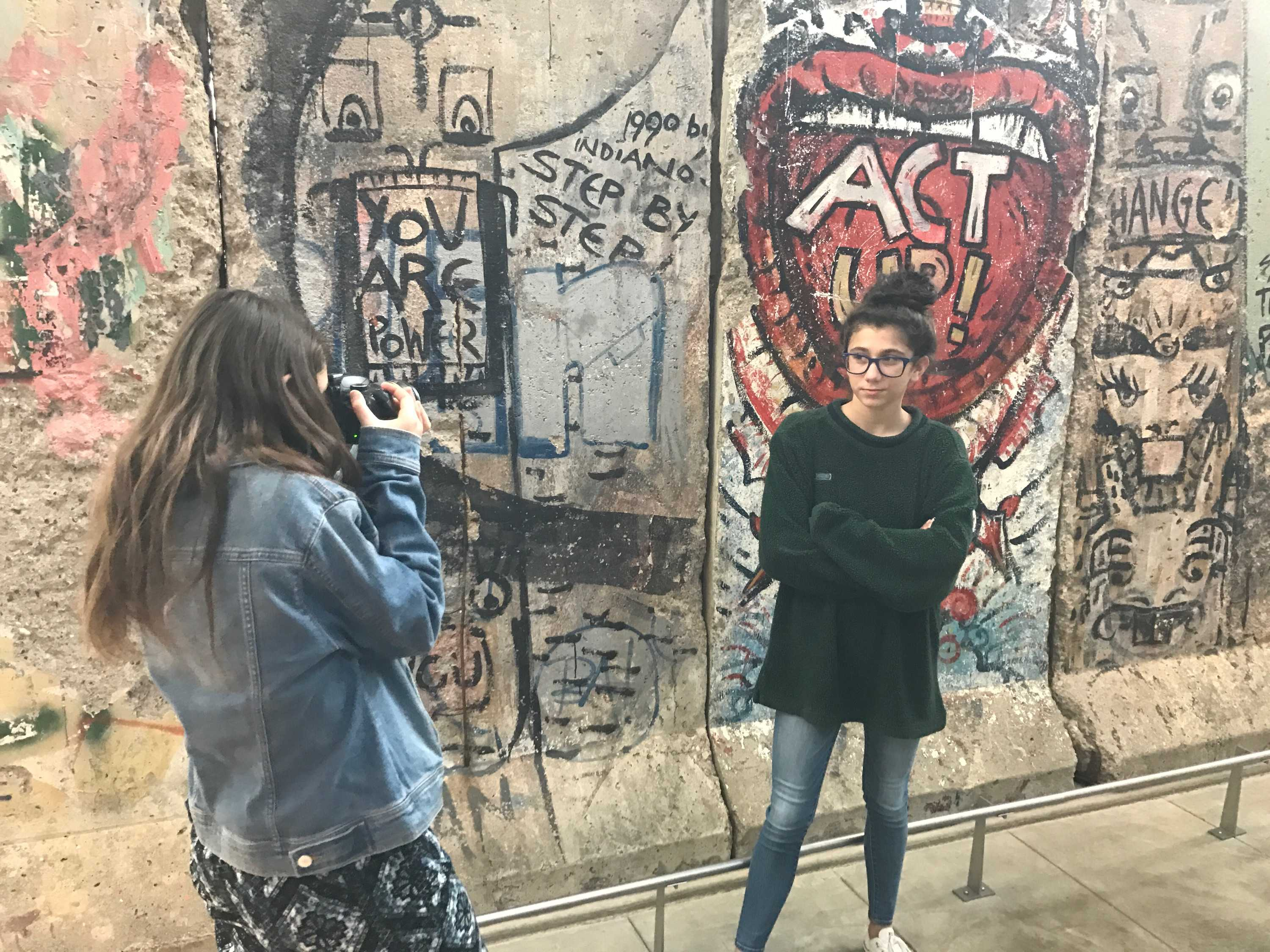 Sophomore Natalia Paley-Whitman takes a picture of sophomore Jessica Beyers in front of the historic Berlin Wall.
