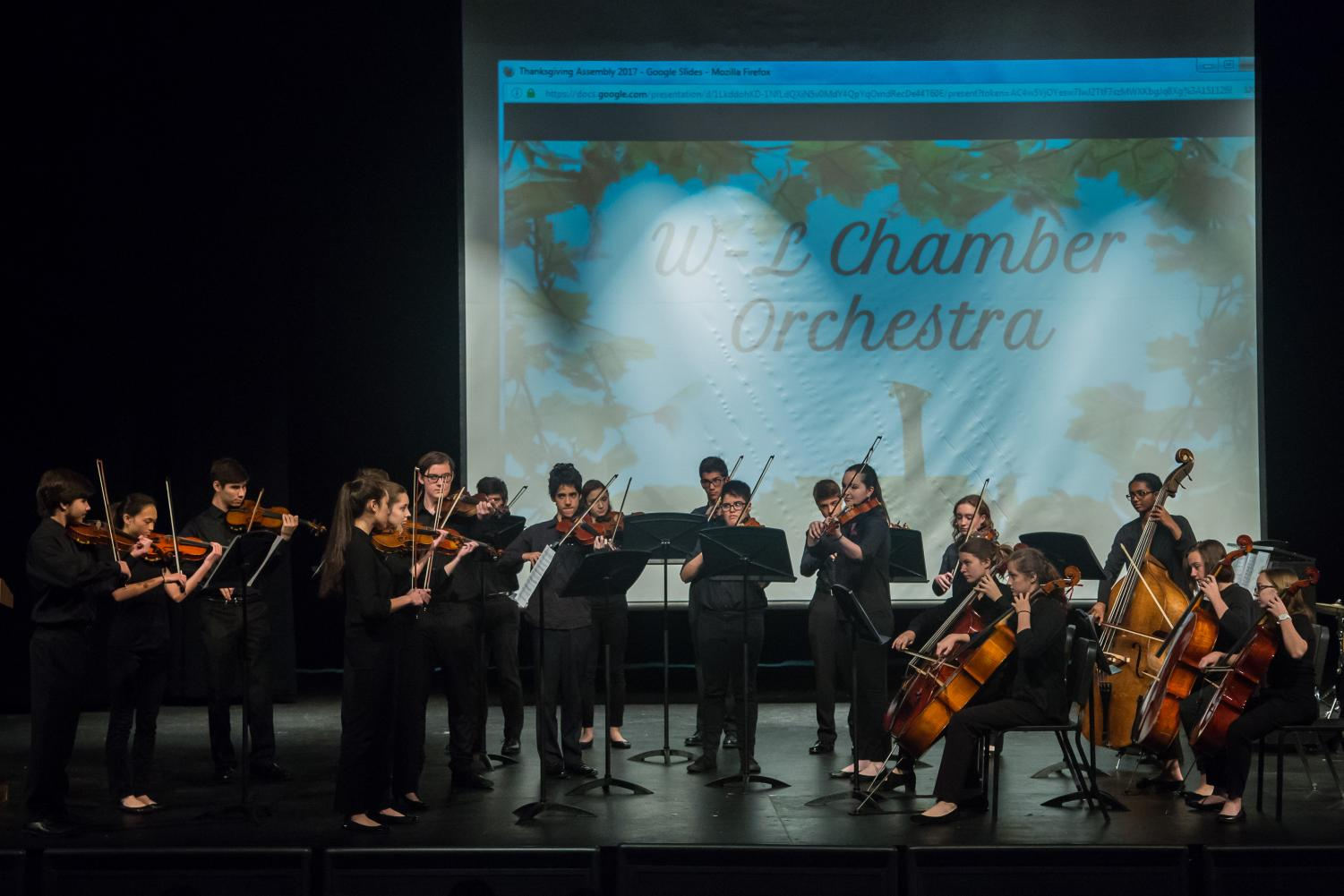 Members of the chamber orchestra perform at this year's Thanksgiving assembly. The annual performance is organized by the Student Council Association (SCA).