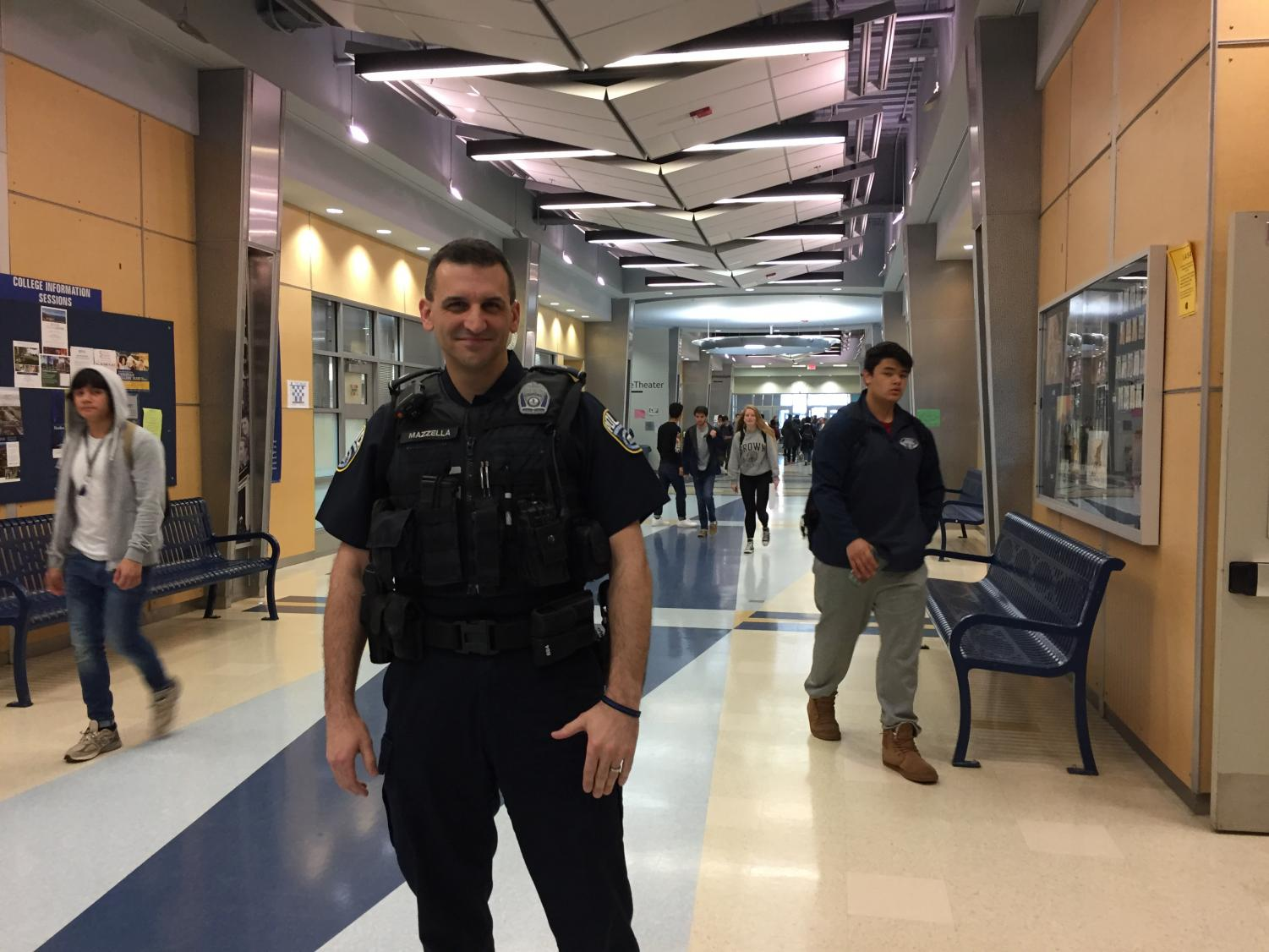 School SRO Marc Mazzella stands in the hallway between classes. Much of the responsibility of handling student crime is given to the SROs.