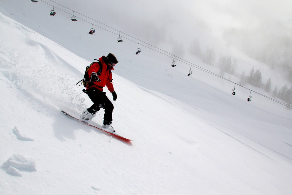 Students participate in snow sports during the cold winter months. Some students prefer snowboarding to skiing.