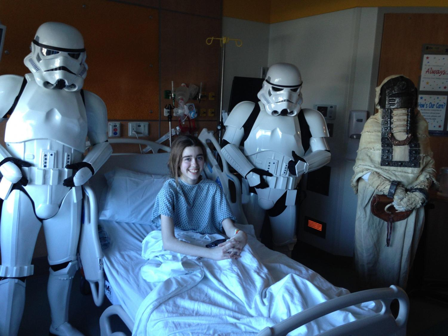 Sophomore Alana McBride is greeted by stormtroopers during one long January stay in the hospital. McBride was later inspired to volunteer in patient care at Inova Fairfax Medical Campus, doing the same job others had done for her.