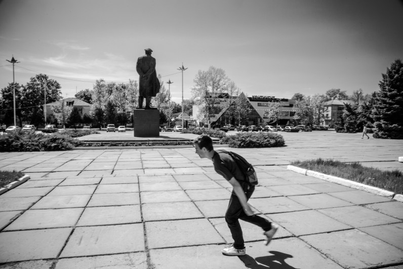 Boy playing in front of Lenin statue in Rybnitsa, a major town in the break-away republic of Transnistria.