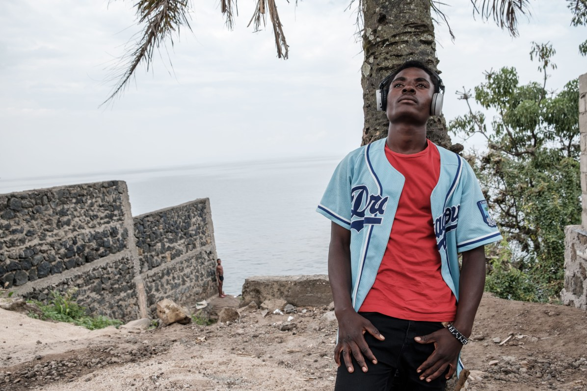 Enoke-B, 24, lives on the shores of Lake Kivu, surrounded by large misty mountains on the border with Rwanda.