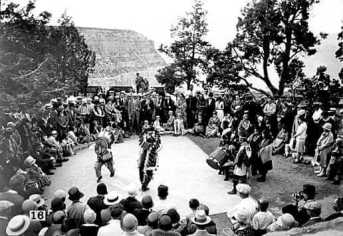 Hopi dancers doing the Victory Dance by Henry G Peabody, 1930 on platform next to Hopi House.