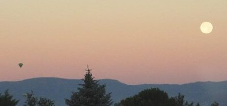 I love to be out in the quiet of predawn, that magical moment when the birds are just starting to sing up the sun. A moment potent with possibility. Image shows balloon rising with Mingus Mountain in background (a holy place in Yavapai and Tonto Apache mythology) and the full moon setting.