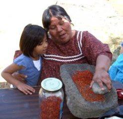 Grinding Lemonberries on stone metate by Sandra Cosentino