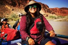 Noelle Kooyahoema sitting in a kayak depicts her as an Ancestral Lands Hopi field supervisor