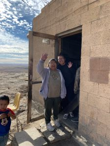 Hopi family waving during the December 2019 delivery of food and gifts during the 21st annual Hopi Holiday Project.