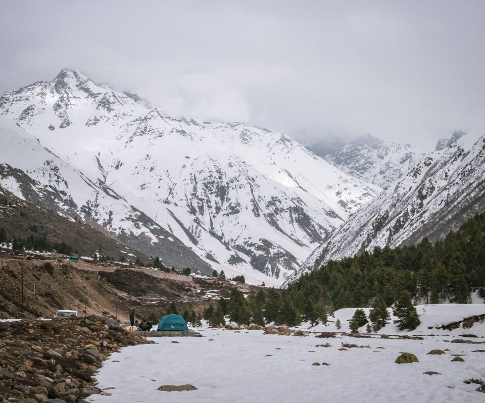People camping in the harsh snow conditions of Chitkul Valley