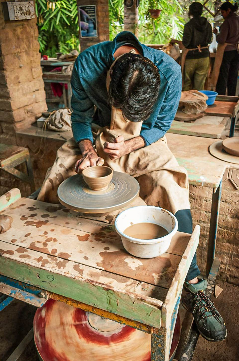 A person self practicing the process involved in pottery making