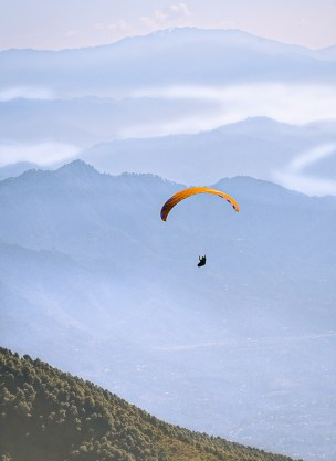 Solo Paraglider on a long walk