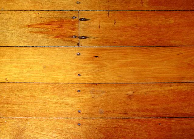 Hardwood floor restoration services by Crown Restoration Services